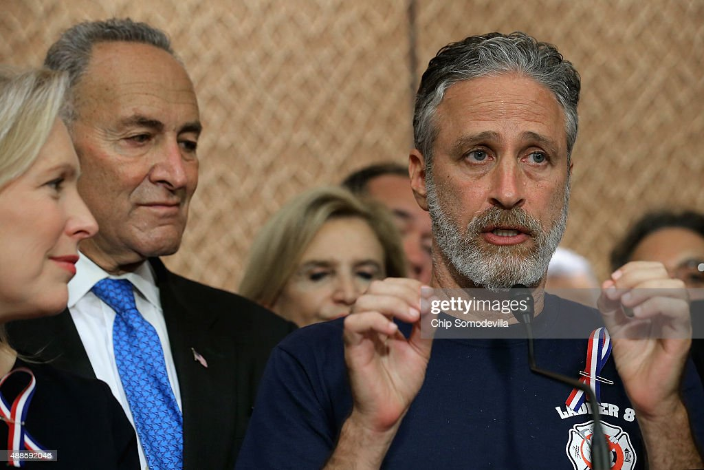 Comedian Jon Stewart (R) speaks during a news conference with Sen. Kirsten Gillibrand (D-NY) (L), Sen. Chuck Schumer (D-NY) and other members of Congress to demand an extension of the Zadroga 9/11 health bill at the U.S. Capitol September 16, 2015 in Washington, DC. The former Daily Show host joined ailing police and firefighters in lobbying Congress for a permanent extension of the Zadroga Act's $1.6 billion health and monitoring effort for the 72,000 emergency responders who worked at Ground Zero.