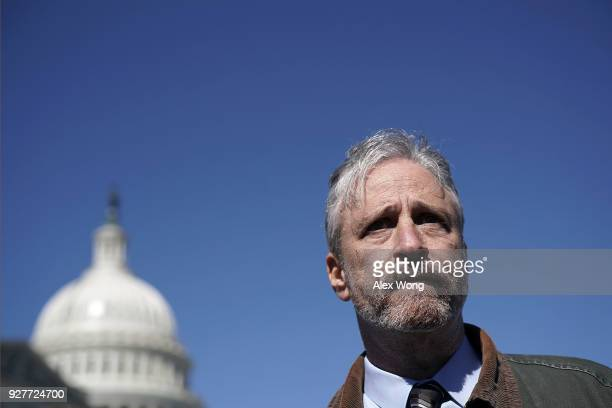Comedian Jon Stewart talks to a member of the media after a news conference March 5 2018 on Capitol Hill in Washington DC Stewart took part in a news...