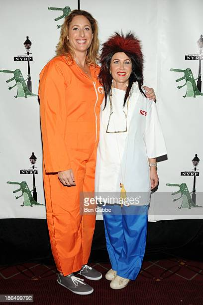 Comedian Judy Gold and Elysa Halpern attend the 18th Annual Hulaween In The Big Easy Event at The Waldorf=Astoria on October 31 2013 in New York City