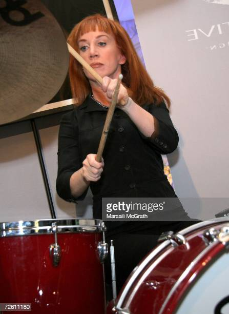 Comedian Kathy Griffin plays the drums at the Gibson display backstage at the American Music Awards with distinctive assets held at the Shrine...