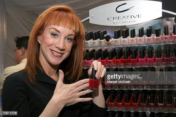 Comedian Kathy Griffin poses with the Creative Nail Design display backstage at the American Music Awards with distinctive assets held at the Shrine...
