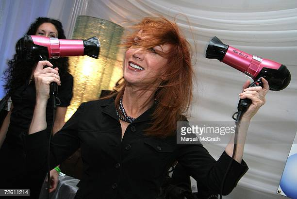 Comedian Kathy Griffin poses with the Dr Spela Hair display backstage at the American Music Awards with distinctive assets held at the Shrine...