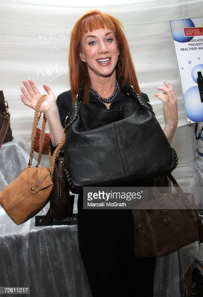 Comedian Kathy Griffin poses with the Elliott Lucca display backstage at the American Music Awards with distinctive assets held at the Shrine...