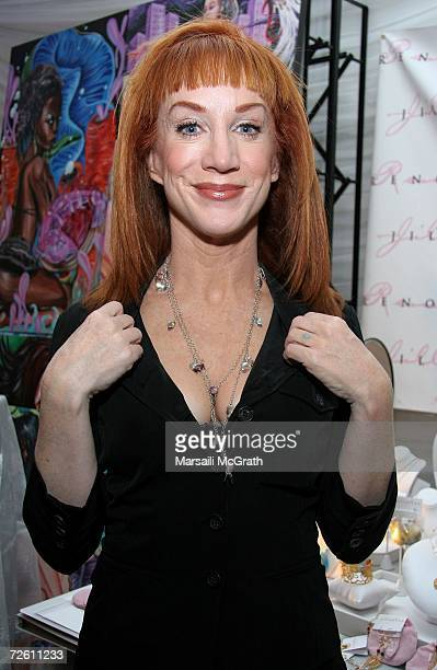 Comedian Kathy Griffin poses with the Jill Reno display backstage at the American Music Awards with distinctive assets held at the Shrine Auditorium...