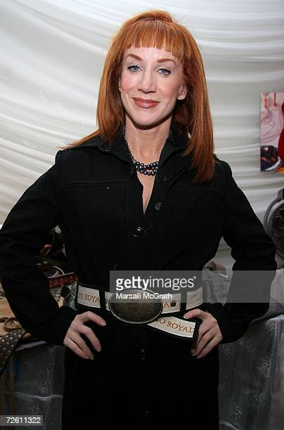 Comedian Kathy Griffin poses with the Latino Royalty display backstage at the American Music Awards with distinctive assets held at the Shrine...