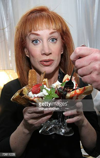 Comedian Kathy Griffin poses with the Mrs Smith display backstage at the American Music Awards with distinctive assets held at the Shrine Auditorium...