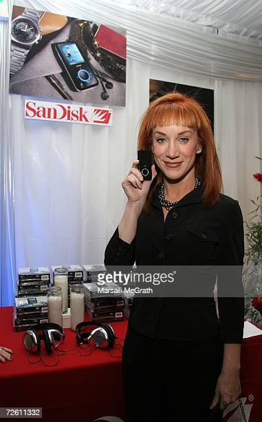 Comedian Kathy Griffin poses with the Sansa display backstage at the American Music Awards with distinctive assets held at the Shrine Auditorium on...