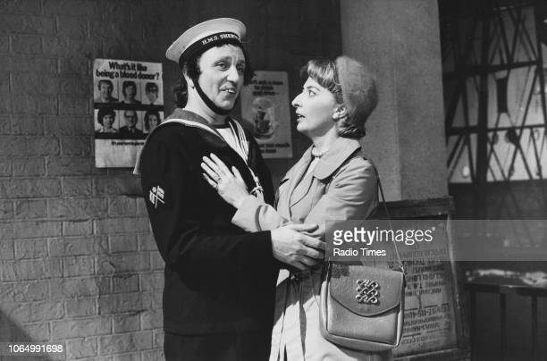 Comedian Ken Dodd dressed as a sailor in a scene from the comedy television show 'Ken Dodd's World of Laughter' with actress Jo Manning Wilson...