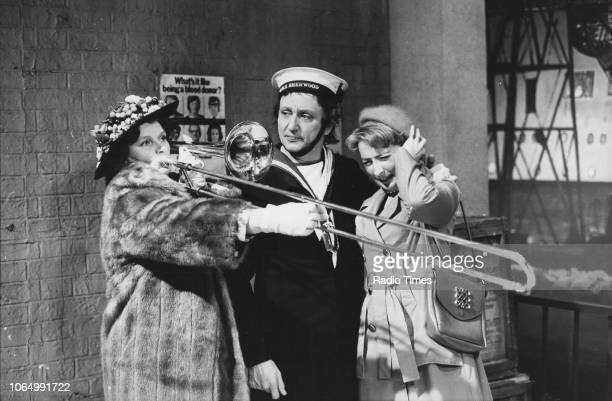 Comedian Ken Dodd dressed as a sailor in a scene from the comedy television show 'Ken Dodd's World of Laughter' with actresses Hilda Fenemore and Jo...