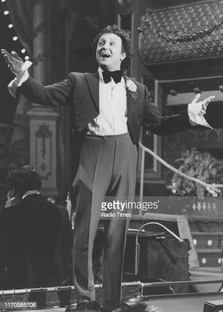Comedian Ken Dodd on stage for the BBC television show 'The Good Old Days', March 1st 1974.