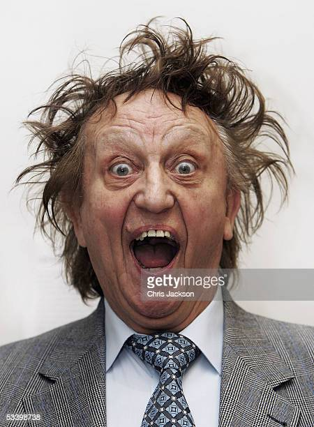 Comedian Ken Dodd poses at the unveiling a new portrait of himself by painter David Cobley at the National Portrait Gallery on August 17 2005 in...