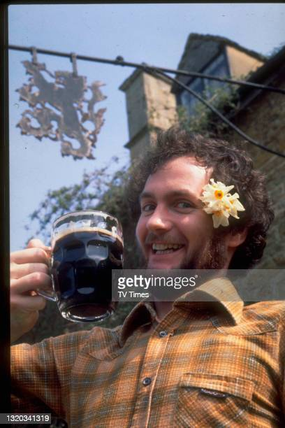 Comedian Kenny Everett drinking a pint of bitter, circa 1978.