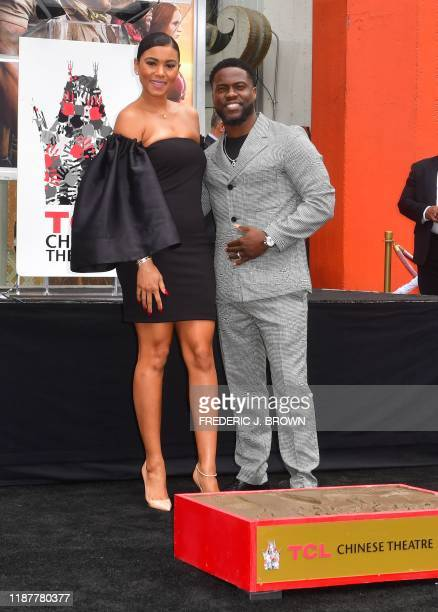 Comedian Kevin Hart and his wife Eniko Parrish at his Hand and Footprints ceremony in Hollywood California on December 10 2019