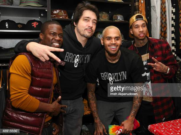 Comedian Kevin Hart Brooklyn Projects CoOwner Founder Dom DeLuca singer Chris Brown and rapper Tyga attend the 1st Annual Xmas Toy Drive hosted by...