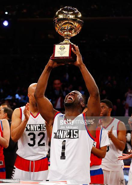 Comedian Kevin Hart celebrates with the MVP trophy after the Sprint NBA AllStar Celebrity Game at Madison Square Garden on February 13 2015 in New...