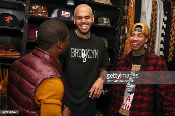 Comedian Kevin Hart singer Chris Brown and rapper Tyga attend the 1st Annual Xmas Toy Drive hosted by Chris Brown and Brooklyn Projects on December...