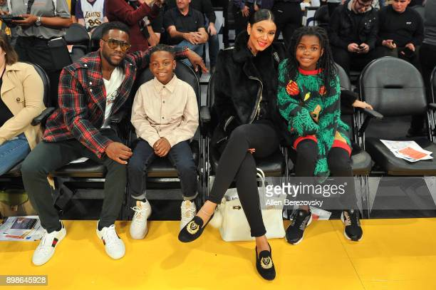 Comedian Kevin Hart son Hendrix Hart wife Eniko Parrish and daughter Heaven Hart attend a basketball game between the Los Angeles Lakers and the...