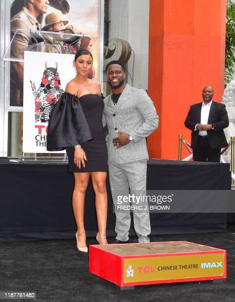 Comedian Kevin Hart with his wife Eniko Parrish poses at his Hand and Footprints ceremony in Hollywood California on December 10 2019