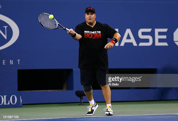 Comedian Kevin James returns a shot during a celebrity doubles match on Day Eleven of the 2012 US Open at USTA Billie Jean King National Tennis...
