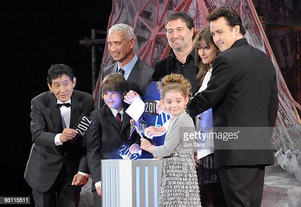 Comedian Kinichi Hagimoto Director Roland Emmerich Producer Harald Kloser Actors Amanda Peet John Cusack Liam James and Morgan Lily attend 2012 Japan...