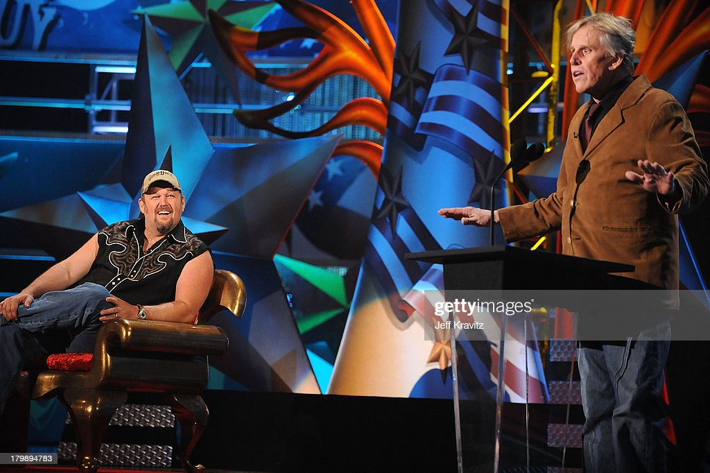 Comedian Larry the Cable Guy and Actor Gary Busey onstage at
