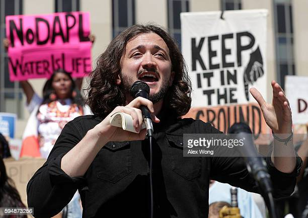 Comedian Lee Camp speaks during a rally on Dakota Access Pipeline August 24 2016 outside US District Court in Washington DC Activists held a rally in...