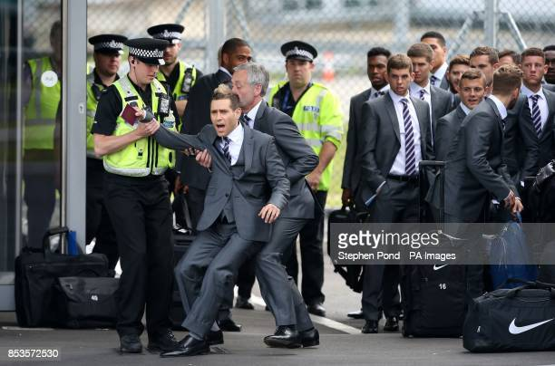 Comedian Lee Nelson is taken away from the England team by security at Luton Airport Luton