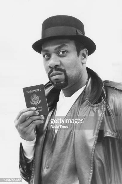 Comedian Lenny Henry holding a US passport in a sketch from the television show 'The Lenny Henry Christmas Show' November 18th 1988