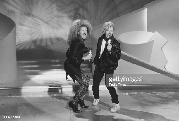 Comedian Les Dennis and singer Joe Longthorne in a sketch from the comedy television series 'The Les Dennis Laughter Show' 1987
