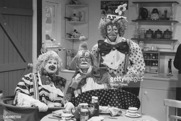 Comedian Les Dennis dressed as a clown with his guests Bella Emberg and Jim Bowen in a sketch from the comedy television series 'The Les Dennis...