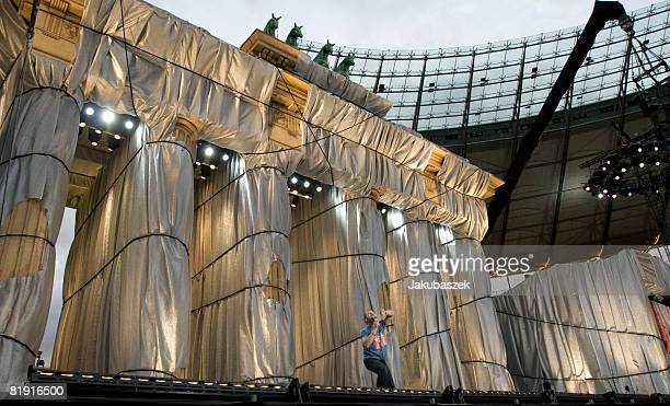 Comedian Mario Barth performs live in front of a large copy of the Brandenburg Gate during a show at the Olympiastadion on July 12 2008 in Berlin...