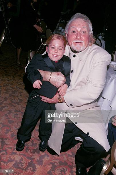 Comedian Marty Ingels right gives actor Josh Ryan Evans a squeeze at The Fifth Annual Golden Satellite Awards January 14 2001 in Beverly Hills CA