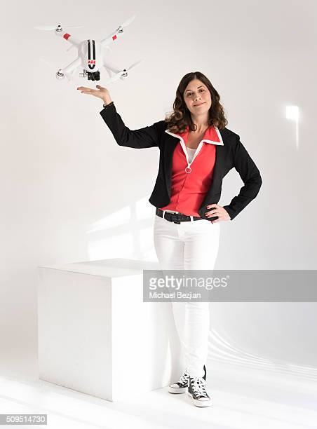 Comedian Mary Gallagher poses for portrait with the AP11 Quadcopter Drone mounted with S61 action camera at the SAP The Starving Artists Project and...