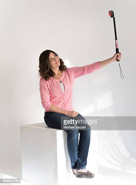 Comedian Mary Gallagher poses for portrait with the S40 Pro Action Cam mounted on Selfie Stick at the SAP The Starving Artists Project and D'Amore's...