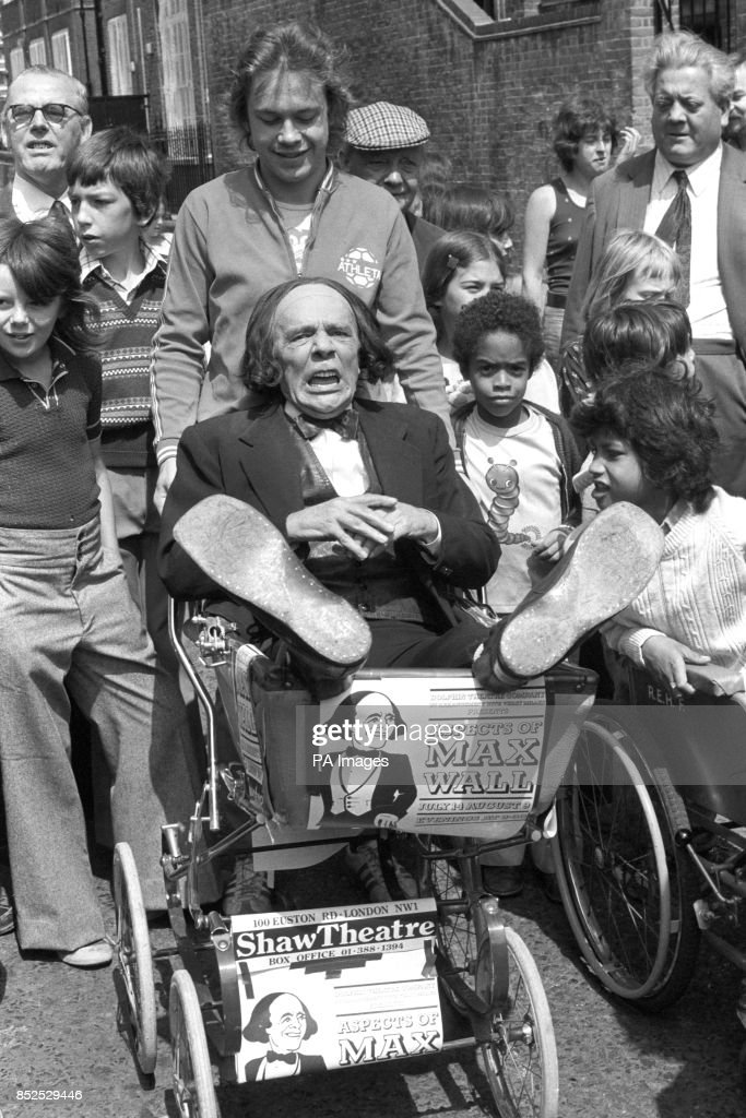 Comedian Max Wall is pushed around in a pram by actor Jonathan Coy. They formed one of the teams entered by the Shaw Theatre in a Pram-Pub Race, part of Camden Council's Somers Town community festival. Max was being pushed to nine pubs, stopping off to drink half a pint of beer at each.