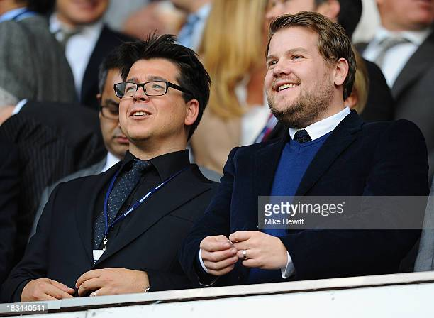 Comedian Michael McIntyre and actor James Corden enjoy the action during the Barclays Premier League match between Tottenham Hotspur and West Ham...