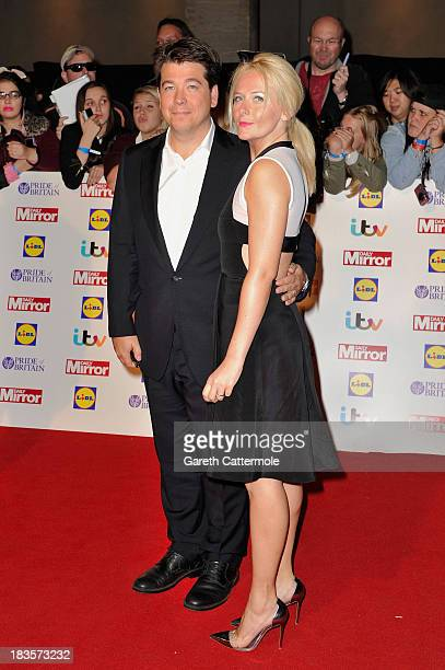 Comedian Michael McIntyre and his wife Kitty McIntyre attend the Pride of Britain awards at Grosvenor House on October 7, 2013 in London, England.