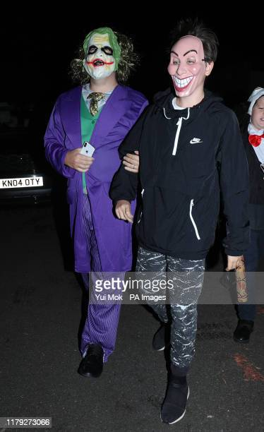 Comedian Michael McIntyre and one of his sons arriving at a Halloween party hosted by Jonathan Ross at his house in north London.