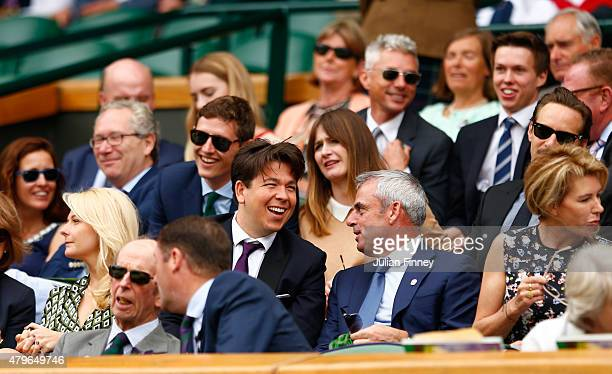 Comedian Michael McIntyre, Paul McGinley and wife Alison McGinley on Centre Court for the Ladies' Singles Fourth Round match between Serena Williams...