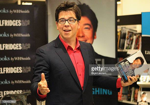 Comedian Michael McIntyre poses with his new book 'Life and Laughing' during a signing at Selfridges on October 14 2010 in London England
