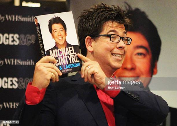 Comedian Michael McIntyre poses with his new book 'Life and Laughing' during a signing at Selfridges on October 14, 2010 in London, England.