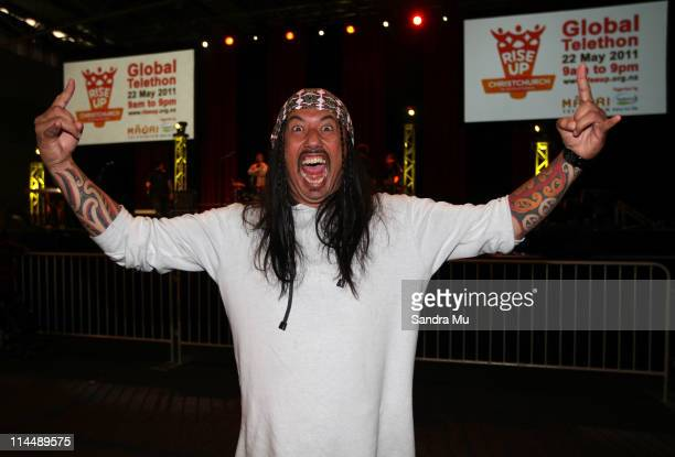 Comedian Mike King shows off new hair extensions during the Rise Up Christchurch telethon appeal event at Trusts Stadium on May 22 2011 in Auckland...