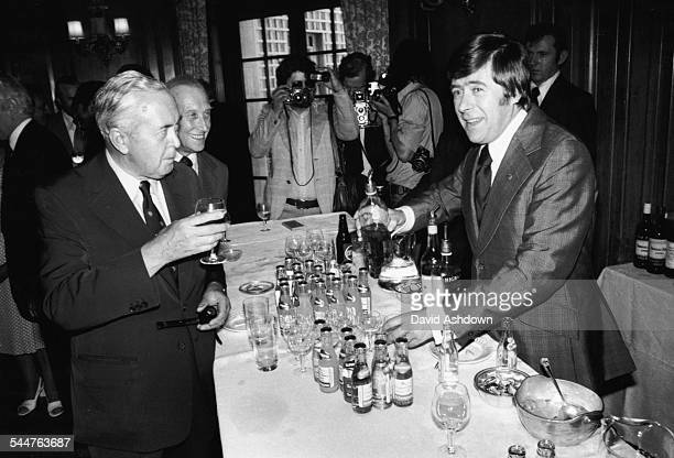 Comedian Mike Yarwood making a drink for former Prime Minister Harold Wilson at the Variety Club of Great Britain's 23rd Ladies Luncheon June 18th...
