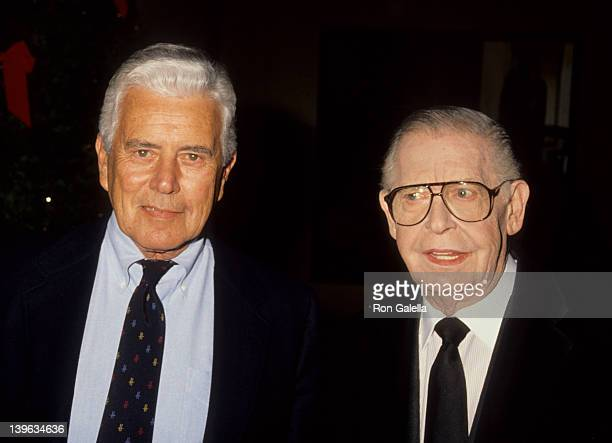 Comedian Milton Berle and actor John Forsythe attending 'Memorial Service for Martin Ritt' on December 17 1990 at the Director's Guild Theater in...