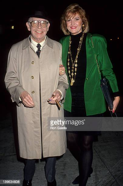 Comedian Milton Berle and wife Lorna Adams being photographed on January 24 1991 at Spago Restaurant in Hollywood California