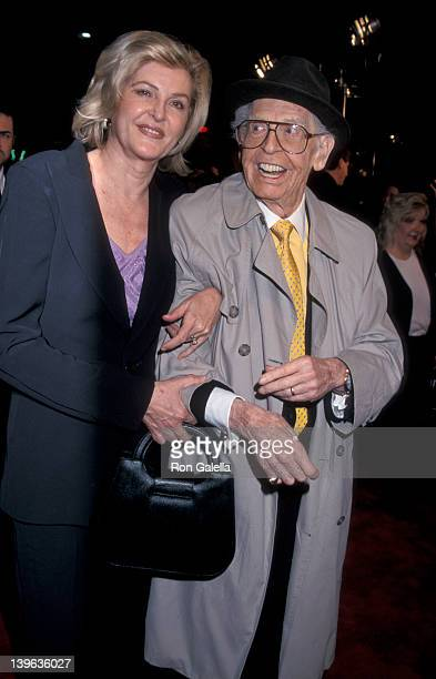 Comedian Milton Berle and wife Lornda Adams attending the world premiere of Analyze This on March 1 1999 at Mann Village Theater in Westwood...