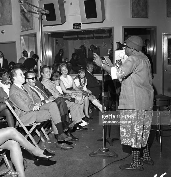 Comedian Moms Mabley performs at a Mercury Records session with Bob Reno publicist Rick Bolsom Helen Berco and Barry Oslander on May 27 1969 at 110 W...