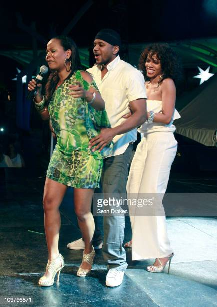 Comedian Nikki Crosby performs with actors Hosea Chanchez and Wendy Racquel Robinson of the BET series The Game at the LIME Carnival fete at Hyatt...