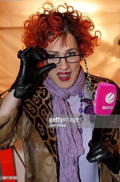 Comedian Oliver Pocher pretends to be a female society reporter for SAT1 television outside the Cinema For Peace Gala on February 15 2010 in Berlin...