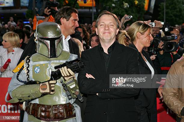 Comedian Olli Dittrich With The Star Wars Bobba Fett figure at the Germany premiere of Star Wars Episode Iii Revenge of the Sith the theater at...